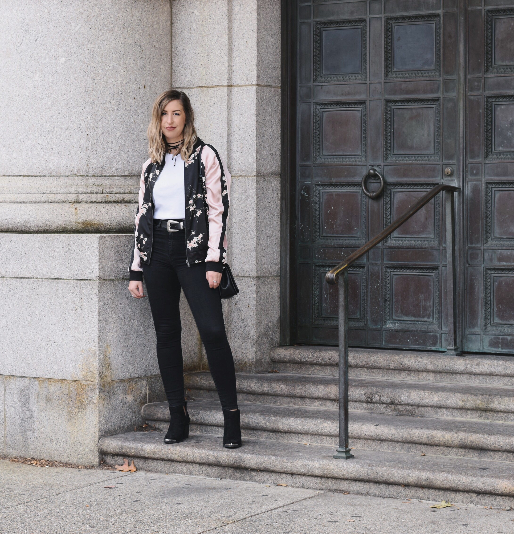 wearing a floral bomber jacket for fall