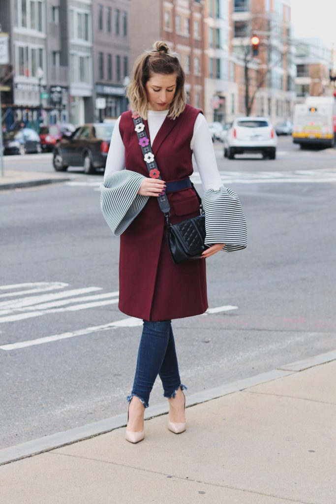 wearing a statement bell sleeve top from Storets